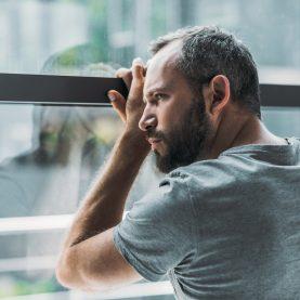 loneliness-man-window